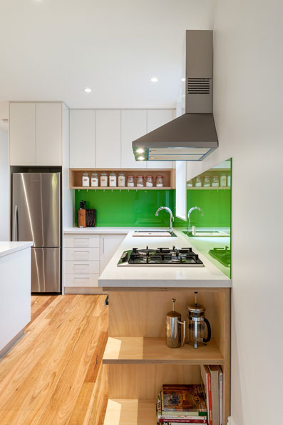 kitchen green sheep collective clean lines exposed plywood passive solar terrace house melbourne timber floors green architect brunswick victoria black