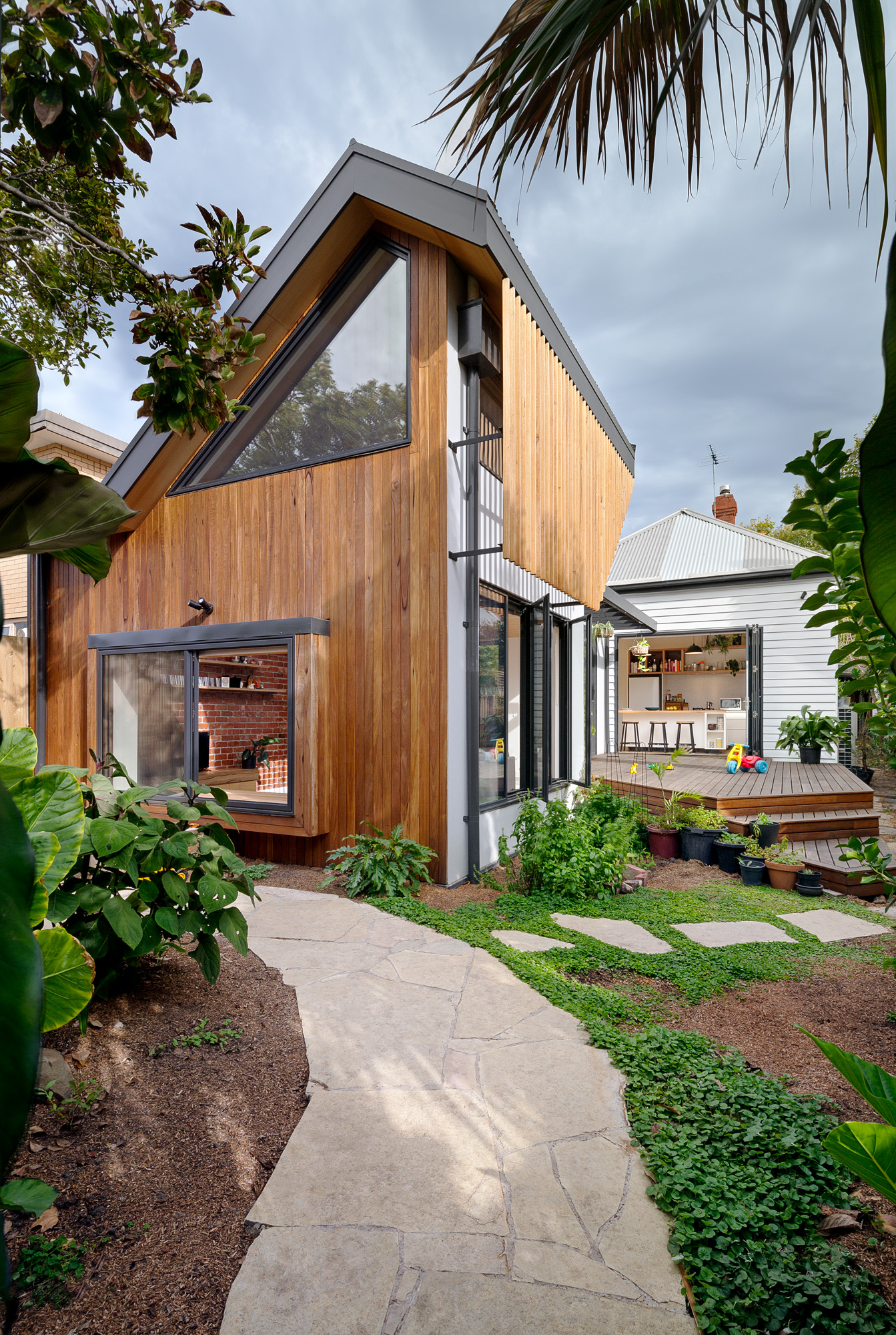 green sheep collective sustainable architect melbourne timber batten shading north facing living spaces.jpg