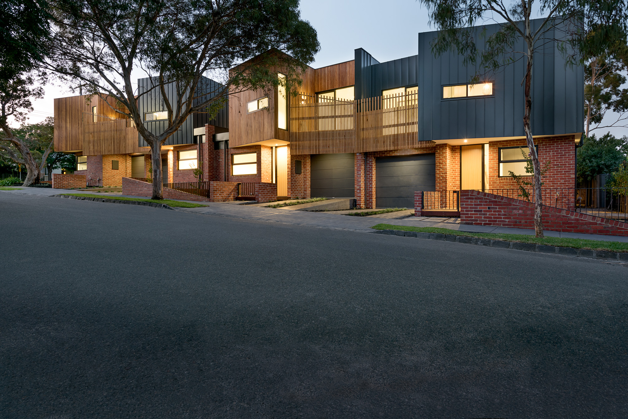 alphington townhouses standing seam radial timber cladding award winning residential architects melbourne