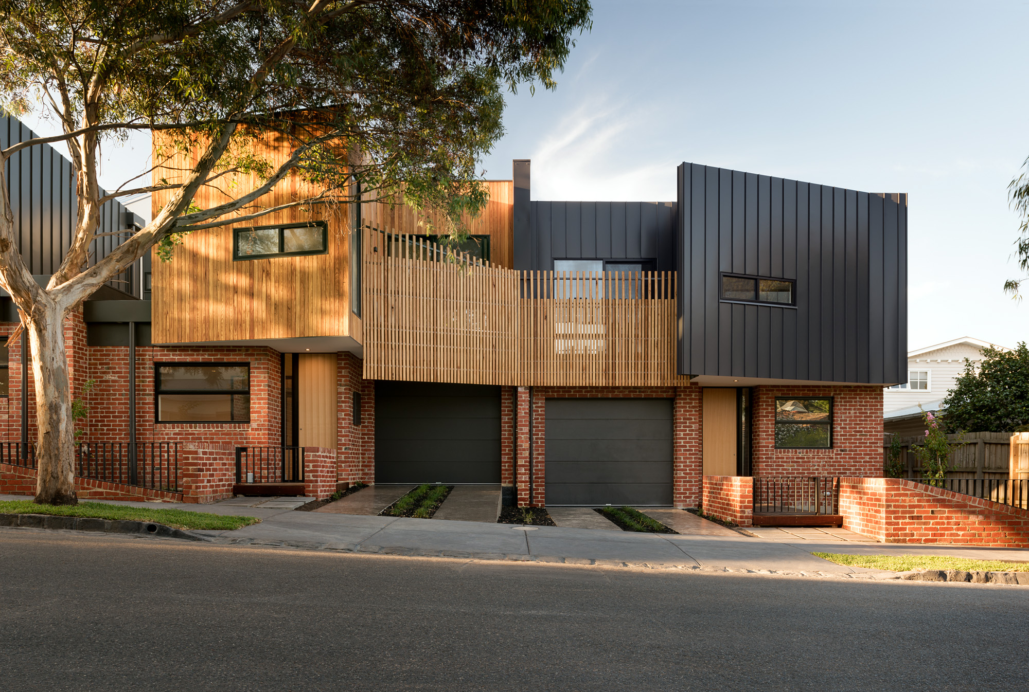 alphington townhouses facade standing seam radial cladding award winning residential architects melbourne