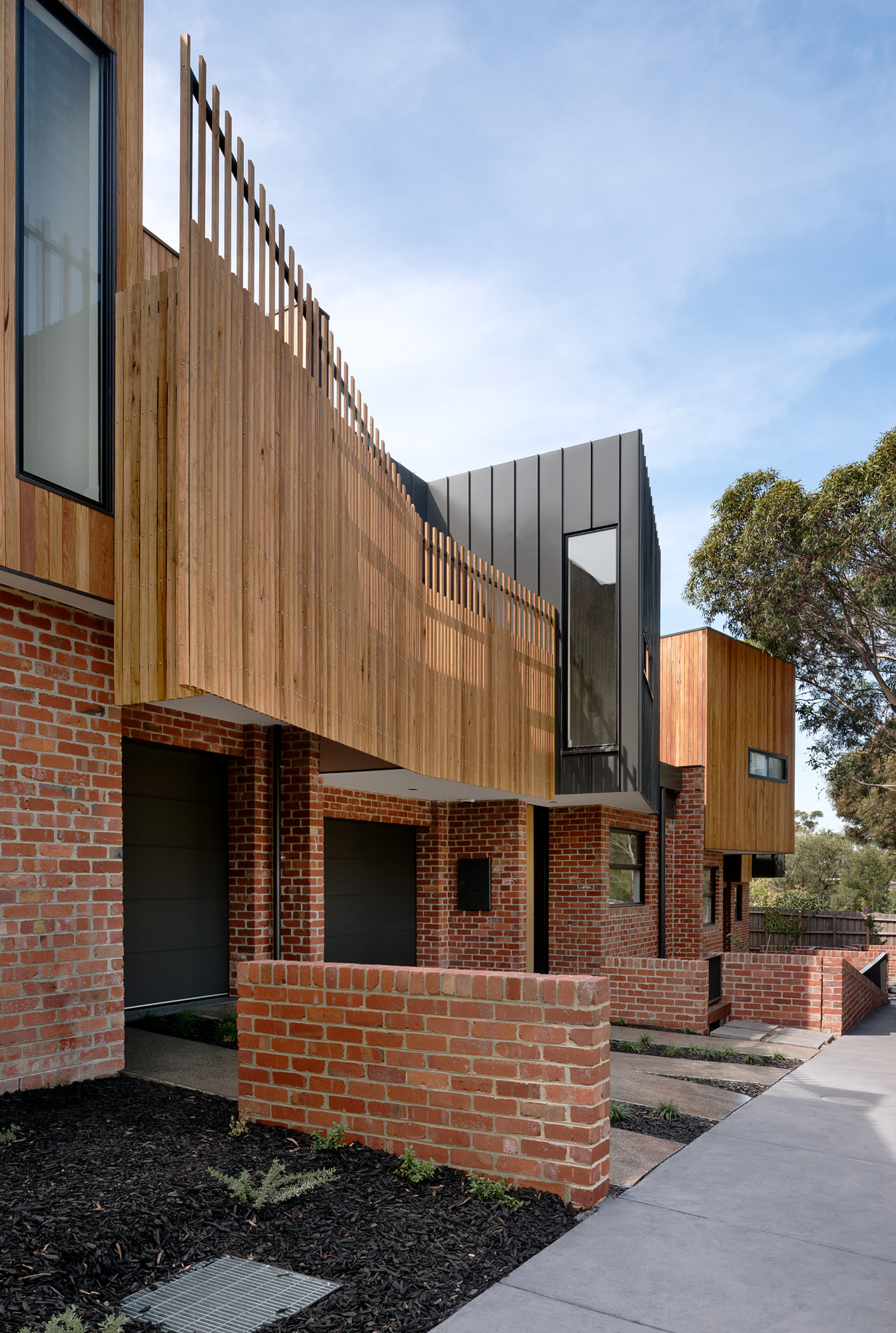 alphington townhouses recycled red brick timber screens award winning residential architects melbourne