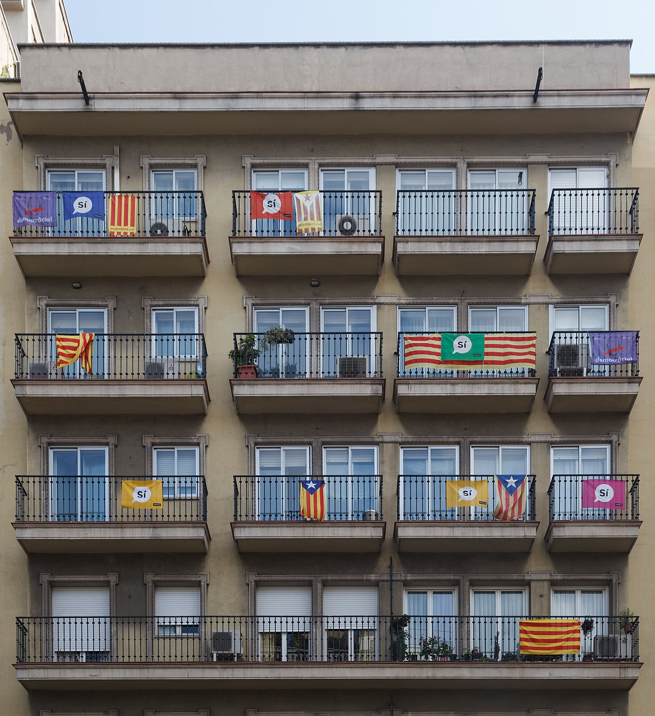 Different versions of the Senyera displayed in Barcelona during the 2017 independence referendum campaign