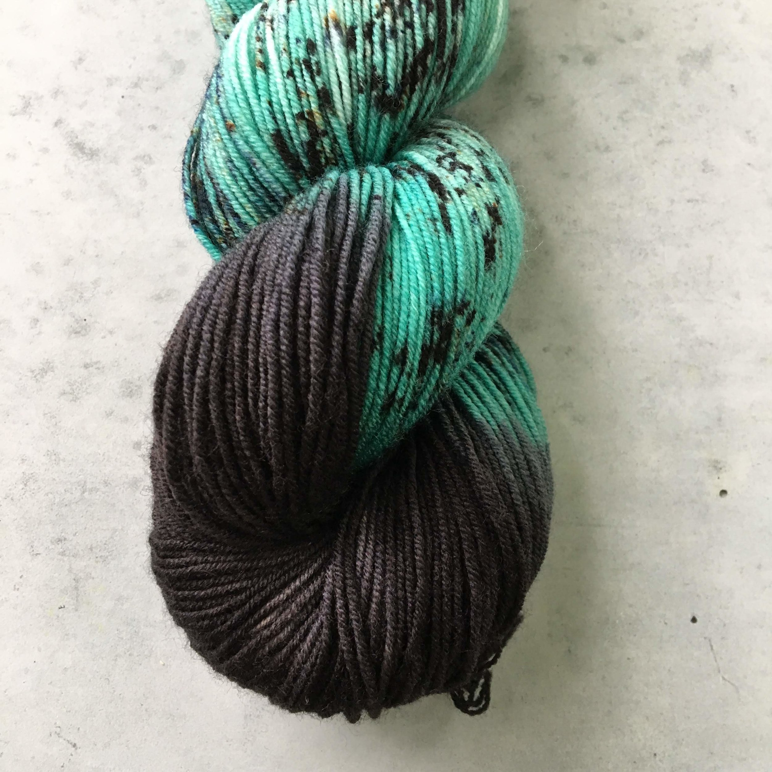 Our new base Alder Fingering in July's Aquatic Club colorway 'Nudibranch Cristada'.