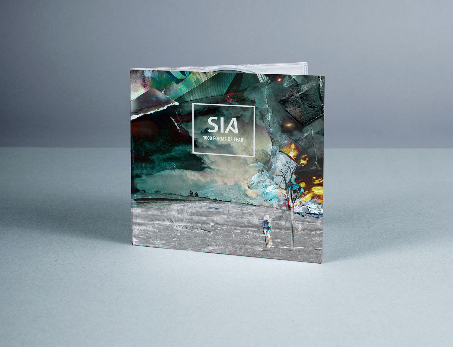 Graphic design CD cover of Sia's Chandelier album 1000 forms of fear, features modern mixed media collage landscape with burning tree and ghostly figure.