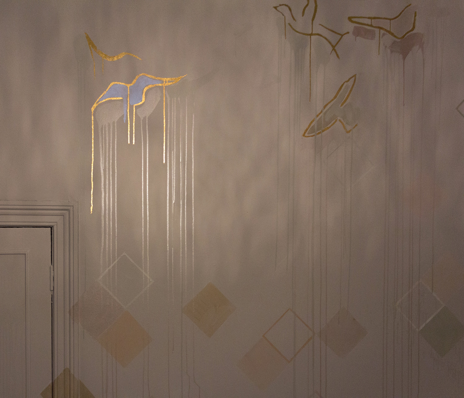 Pastel bedroom mural with gold leaf birds and geometric shapes, one bird is spotlit.