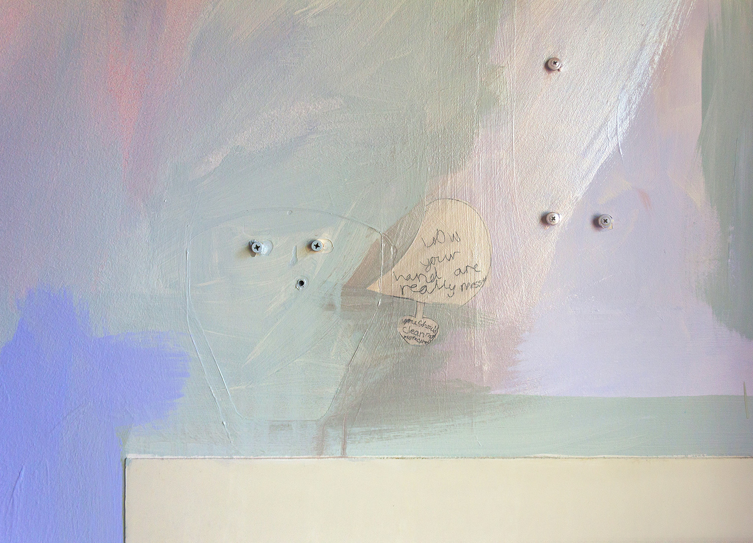 Close up detail of abstract pastel mural featuring a speech bubble with words scribbled by a child. 'Wow your hand are really messy you should clean them.""