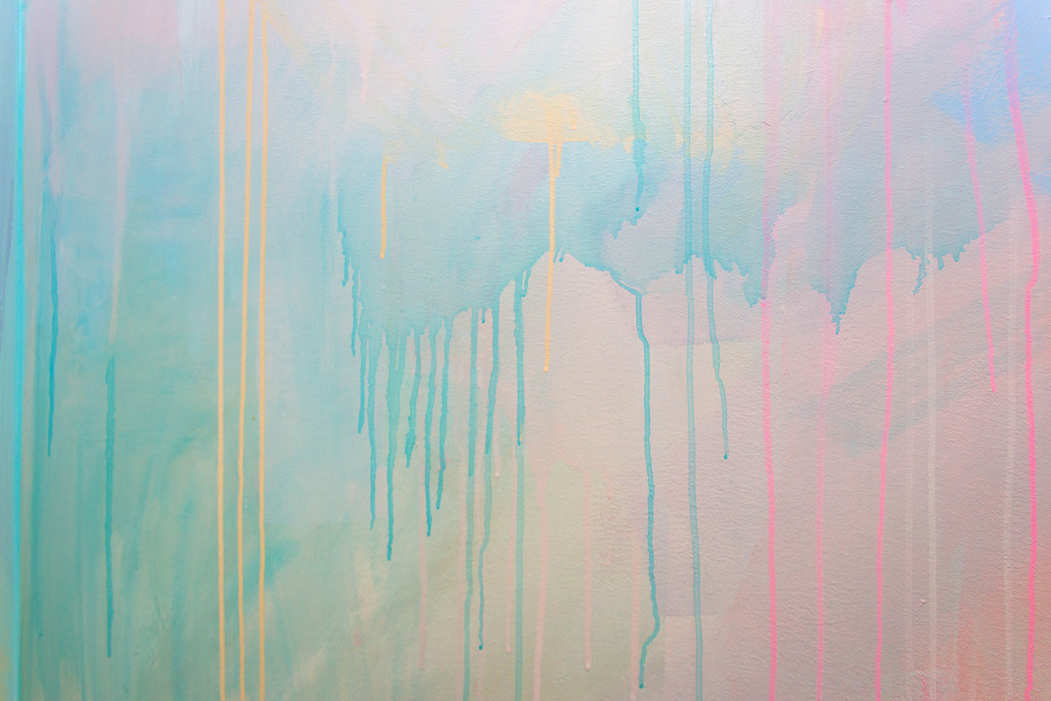 Close up detail of abstract pastel mural featuring dripping paint.