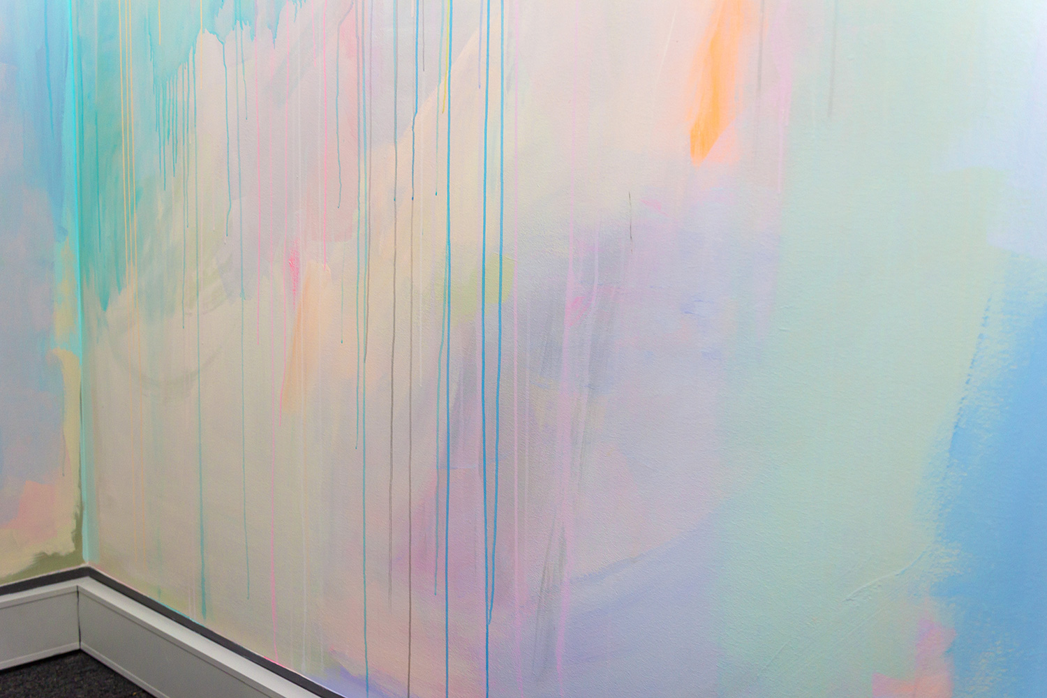 Close up detail of pastel mural featuring dripping paint.