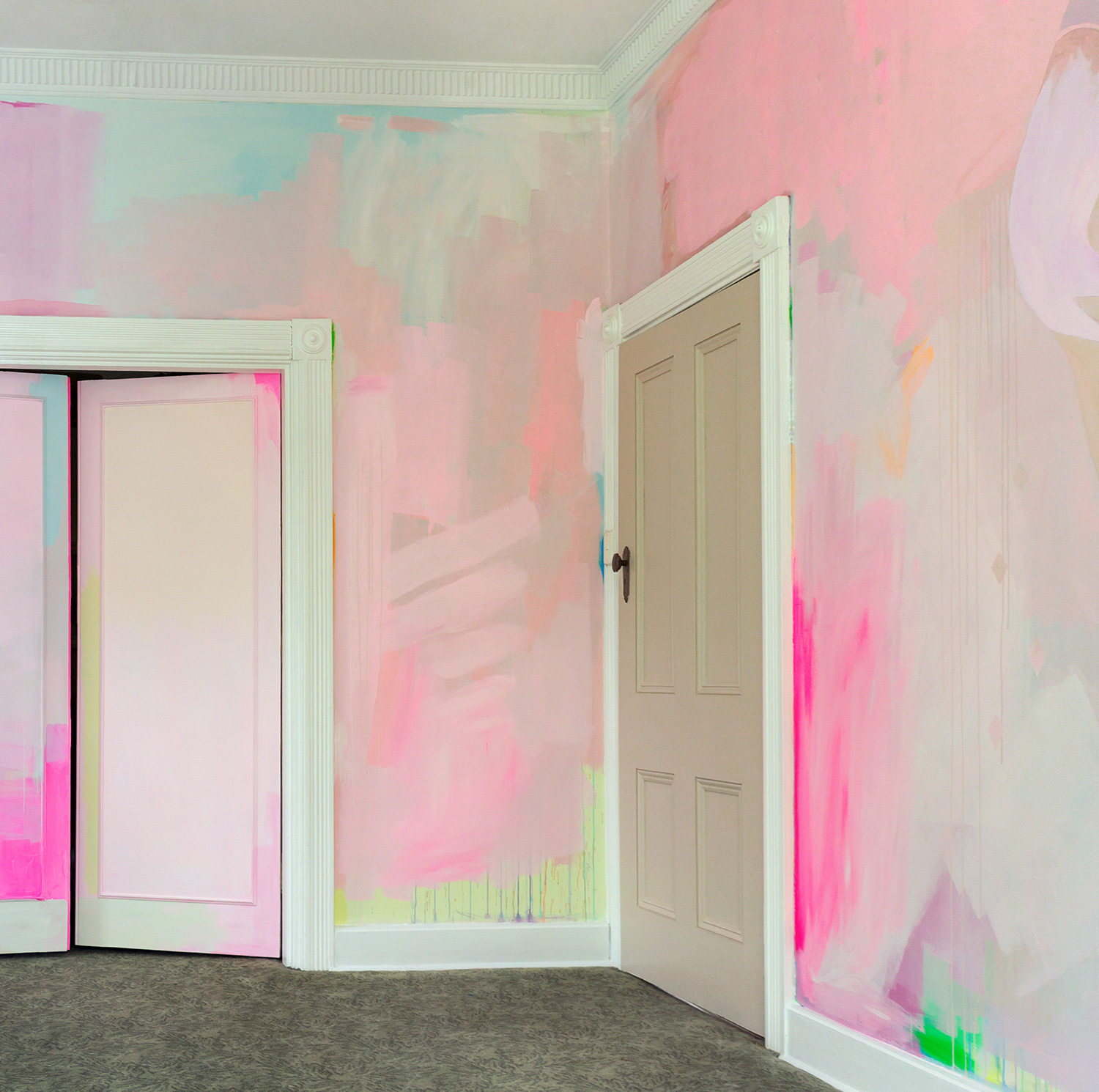 Modern abstract mural features splashes of pastel paint and pops of neon color.