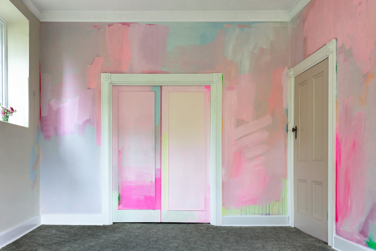 Modern abstract mural features splashes of pastel paint and pops of neon. The color creates an immersive environment - an abstract painting you can step into.