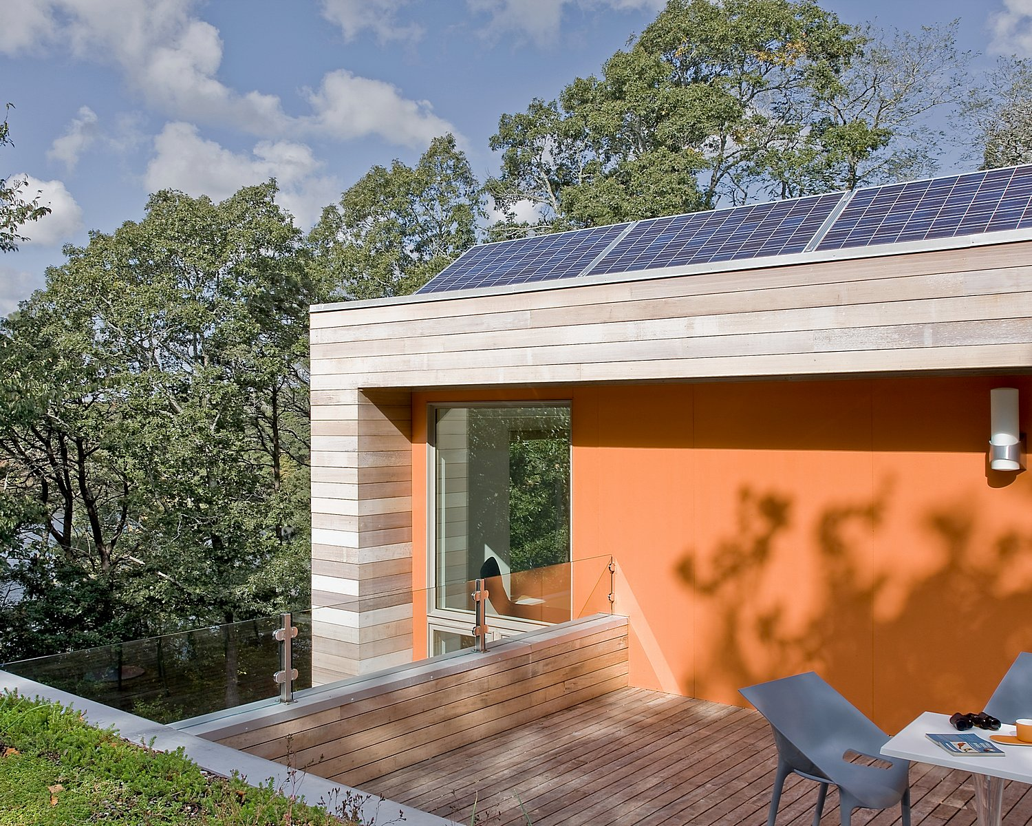 Green home with solar panels on roof