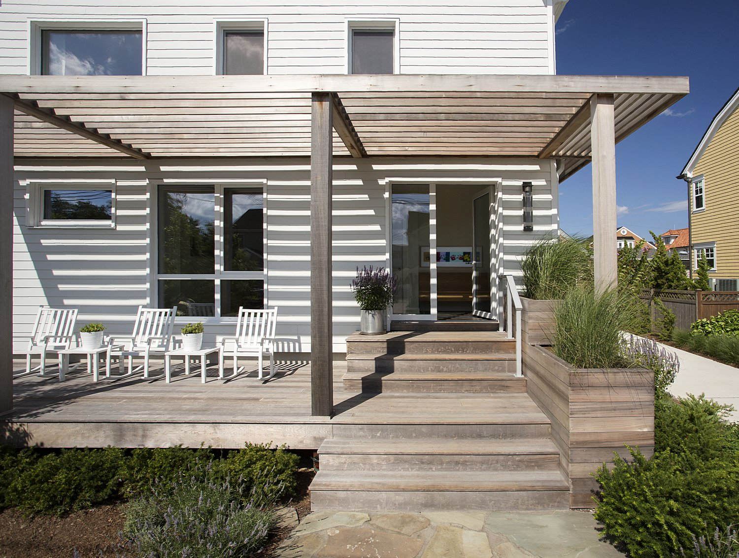 Front entry with porch and trellis