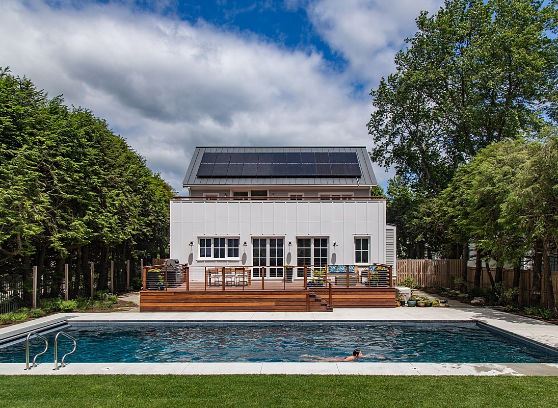 Rear exterior - solar system, pool, and deck