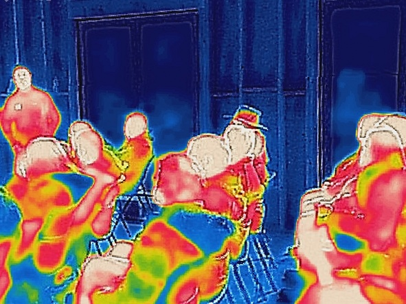 A thermal image shows the warm attendees on the cold and stormy day.