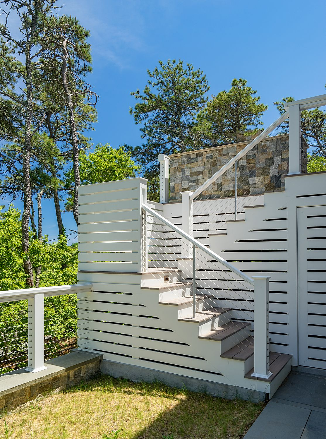 Stairs from deck to outdoor shower