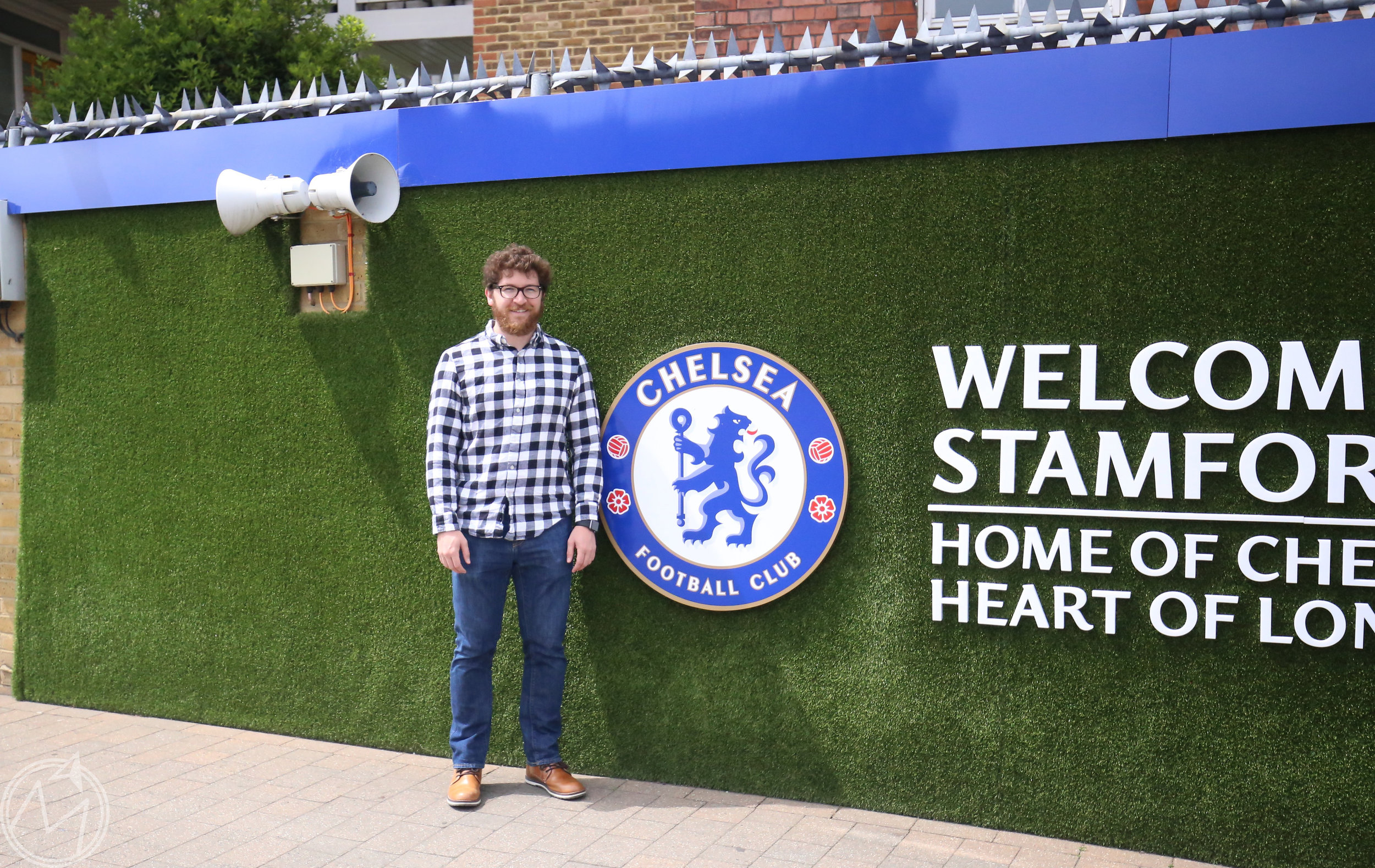 i made him take this picture because chelsea is his premier league team. he only pretended to not be totally into it ;)