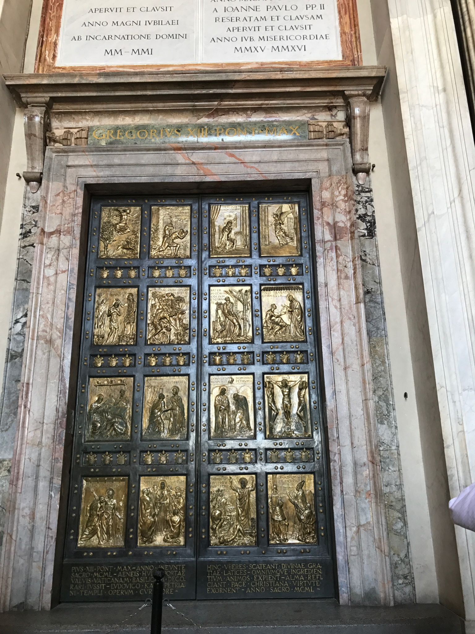 the gates in the narthex of the basilica act as the holy door and are only open during jubilee years of the catholic church.