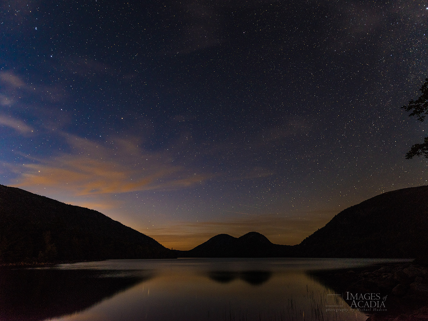 The Night Sky over Jordan Pond, with the Bubble Mountains