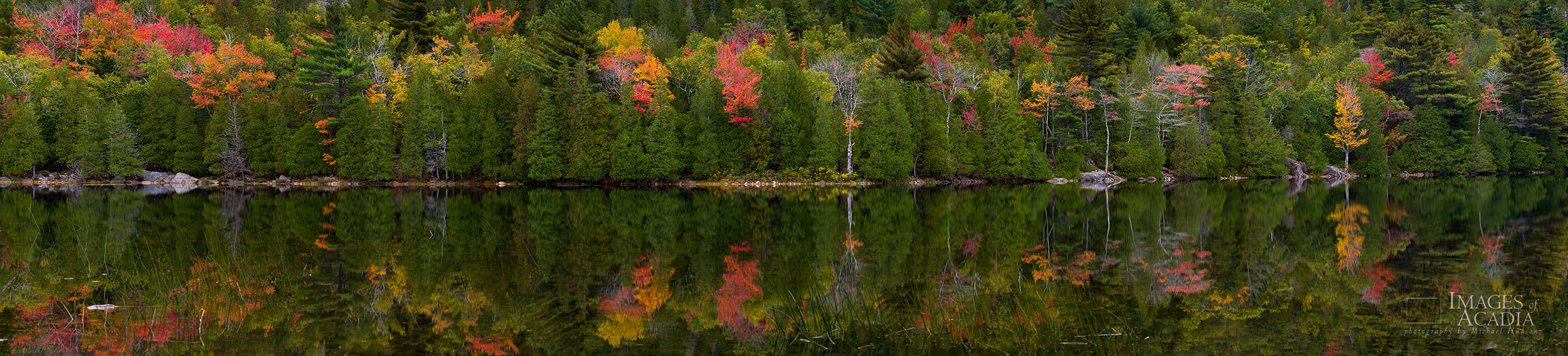 Autumn foliage reflected in the still waters of Bubble Pond