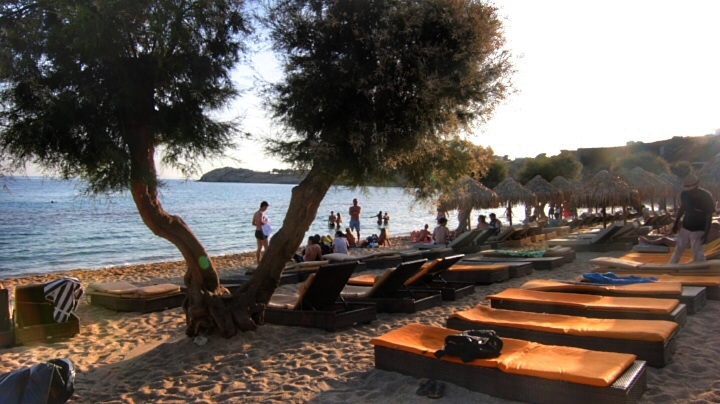Namos and Paradise beach are party oriented beaches. Namos is more fancy,with yachts parked in the ocean, private parking and boutiques. Paradise felt like in spring break. People camp in that area.The waters are clear and scenery is beautiful, but don't expect a quiet beach!