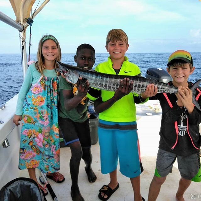 1st wahoo!  Learning how to fish the waters near our village for potential sustainable food sourcs.