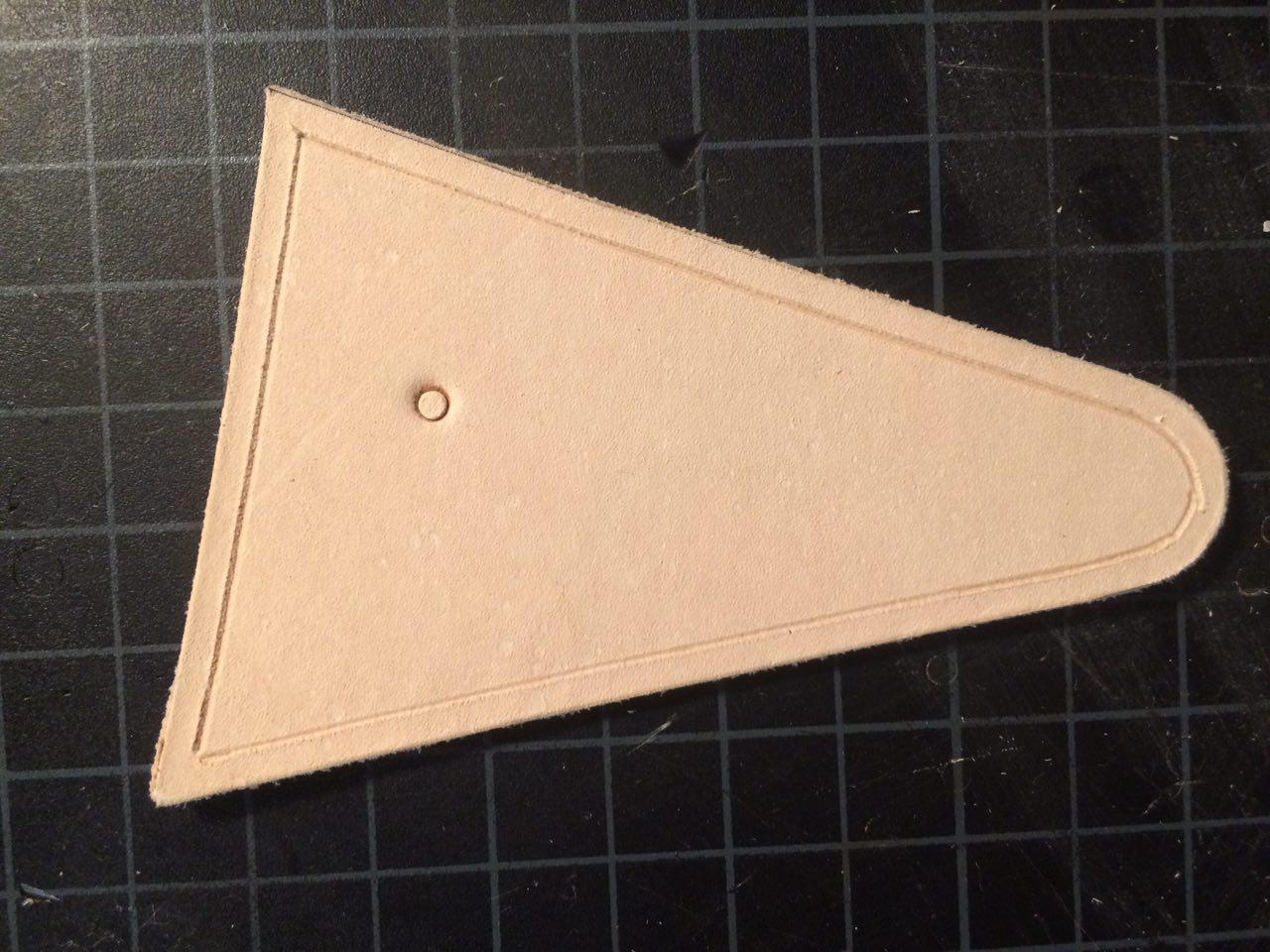 I'll use this piece of scrap leather, that I've already created a stitching channel on, to help explain these three problems.