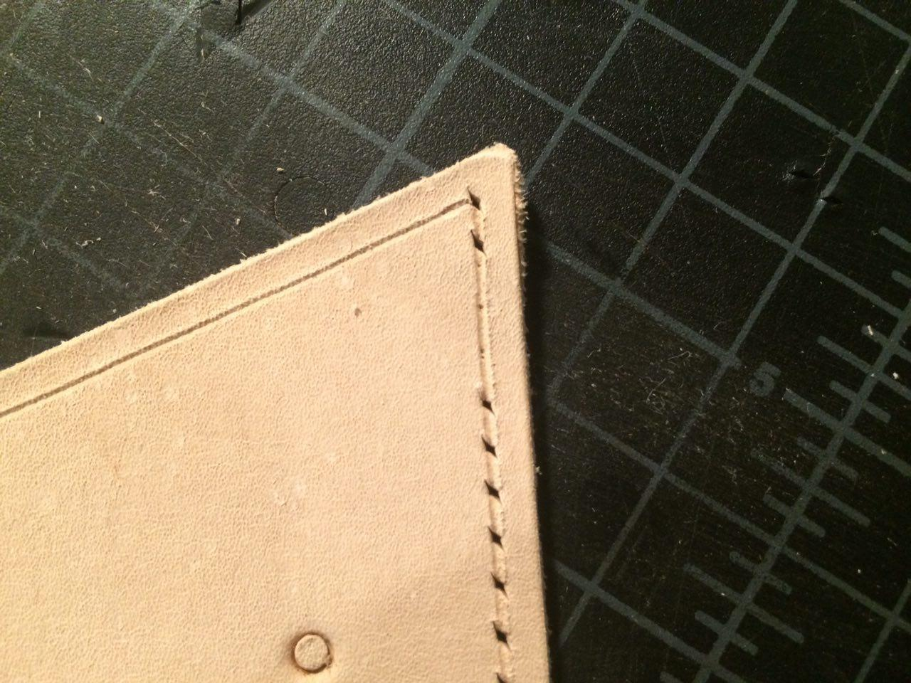 Stop creating stitching holes before you reach the corner. Then put a hole in the corner. (click to enlarge)