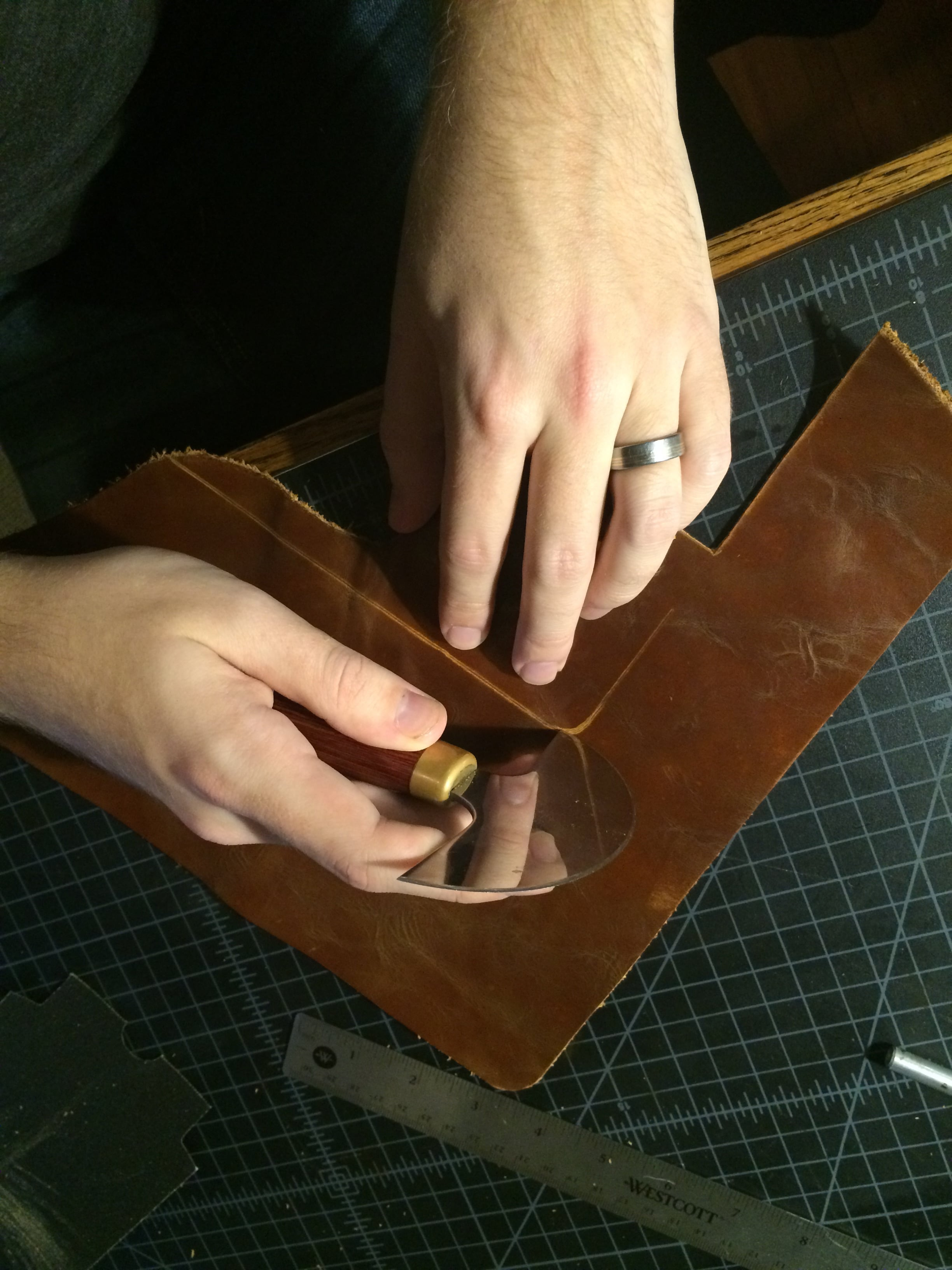 Slowly push the blade forward while rotating the leather with your left hand (click to enlarge).