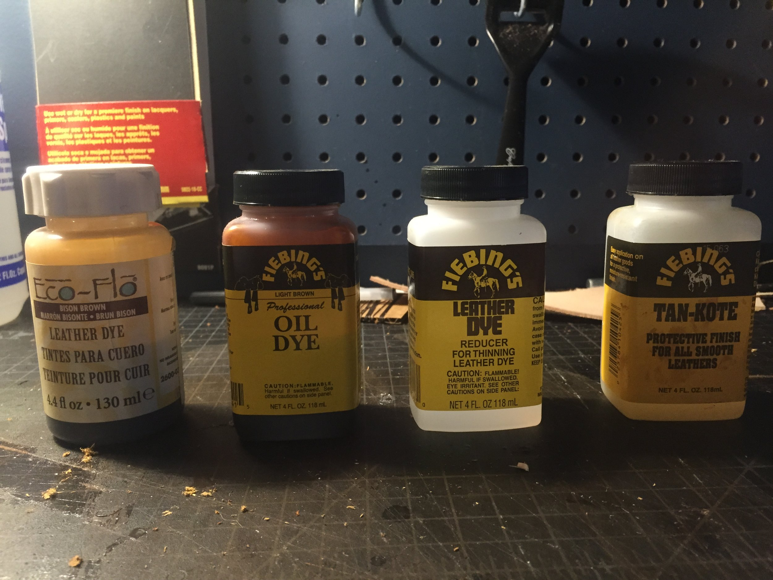 From left to right: Water Based Dye, Oil Based Dye, Dye Reducer, and finally Tan-Kote Leather Finish