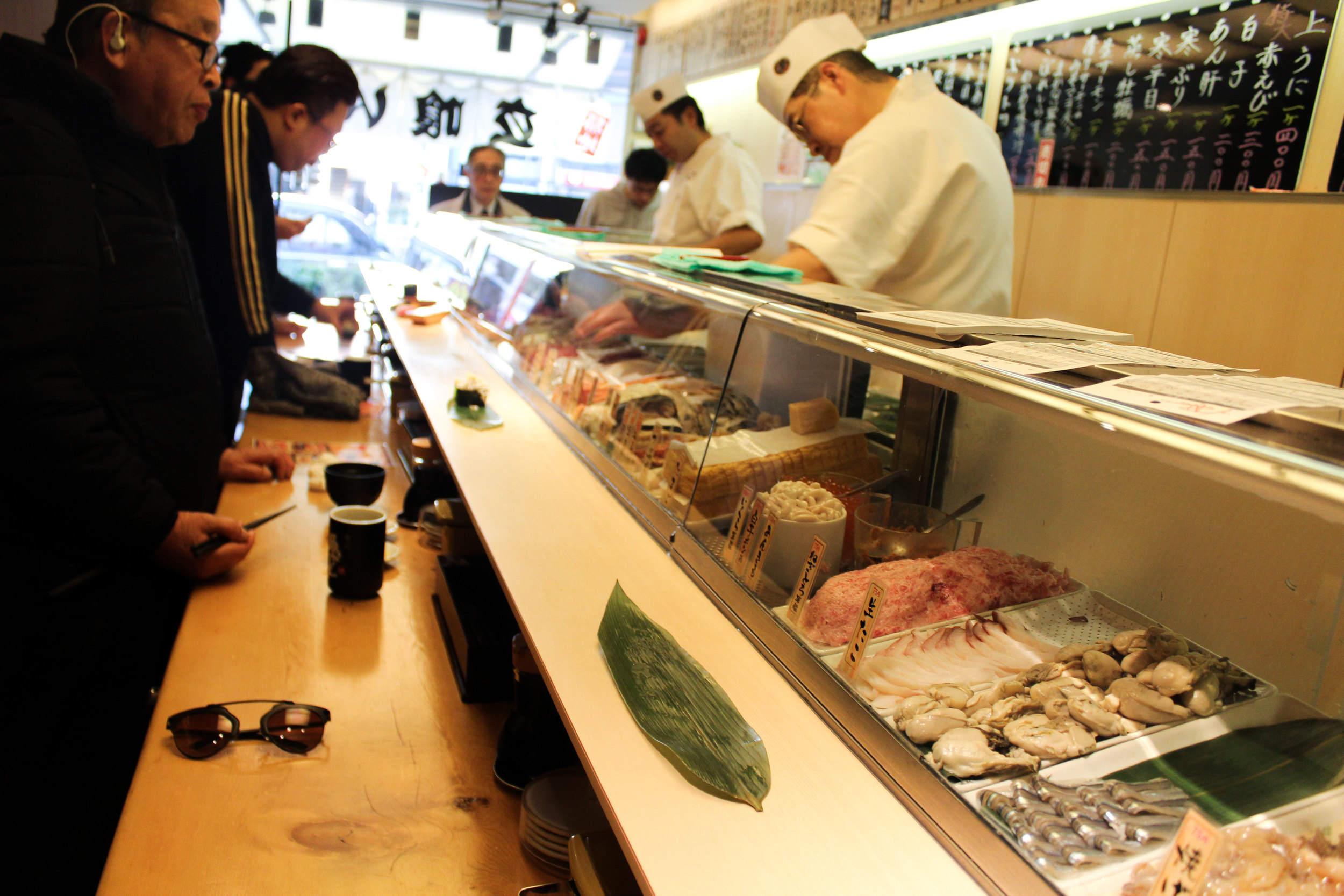 Standing sushi bars are a thing because busy Japanese business men