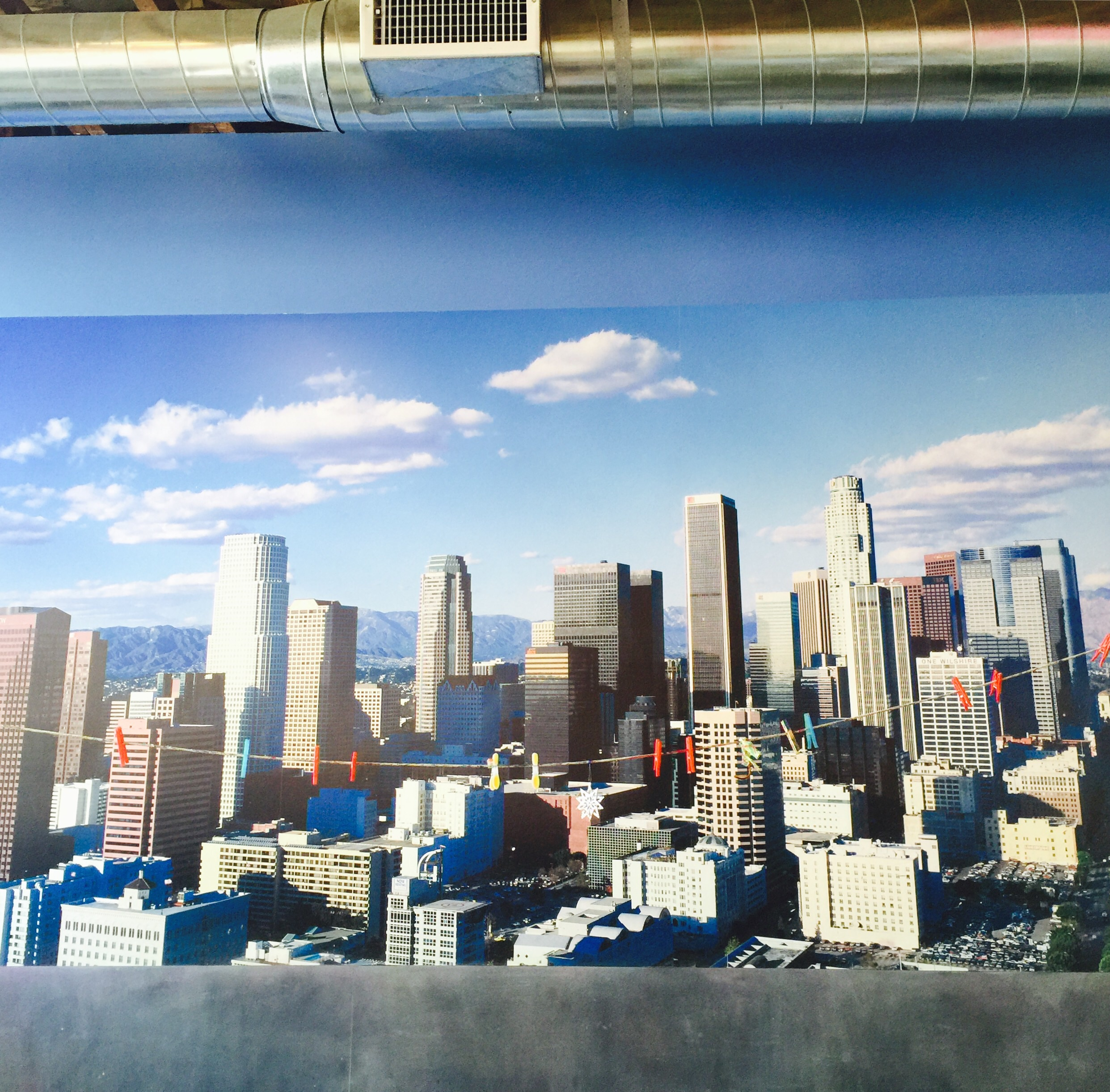 ( Ed. note: neither of our boys painted this. Nor is it the view from Play. It's just a big, cool, photo in the studio.)
