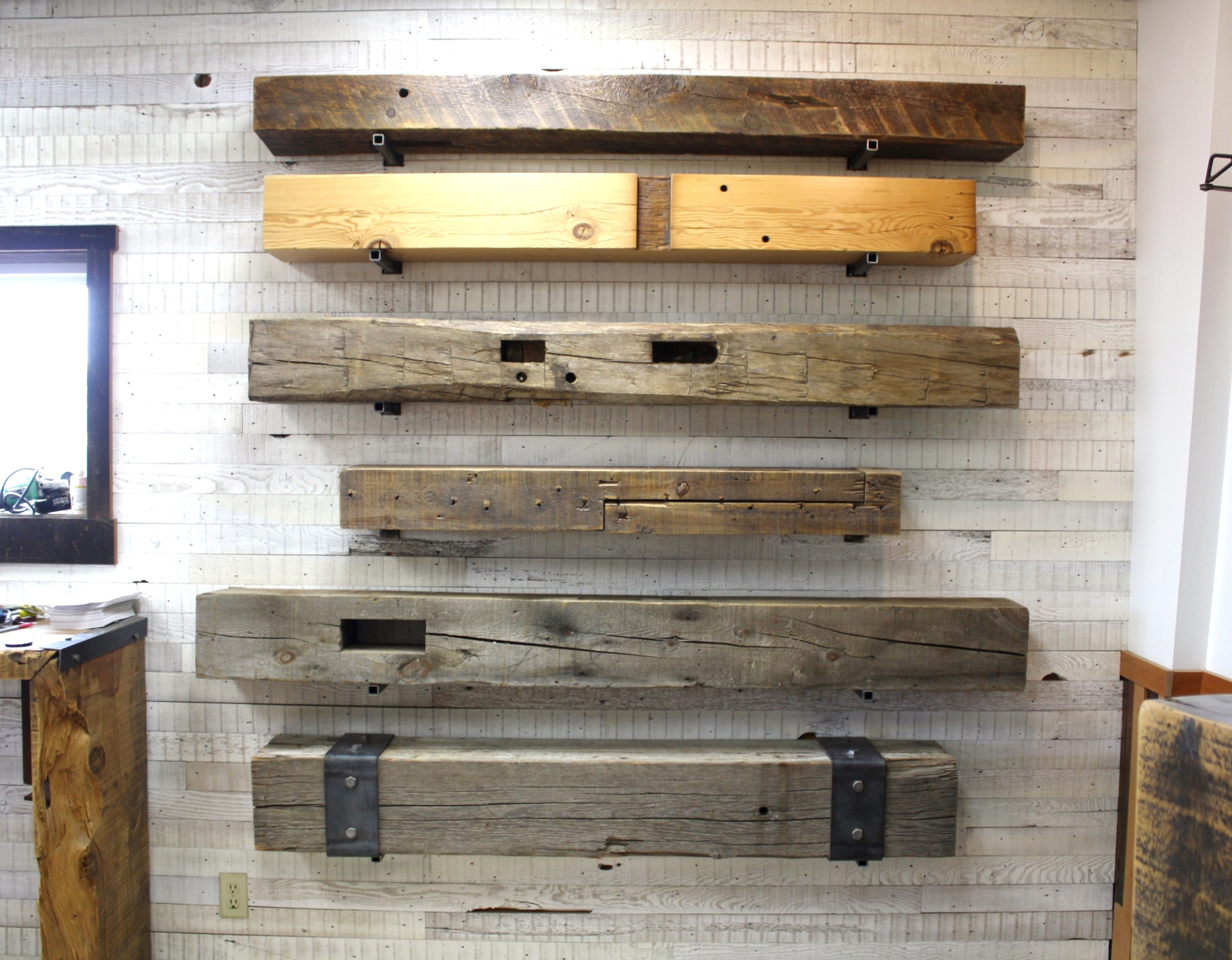 "A variety of mantel styles are on display in our showroom, note that the visible hardware is not the hardware that we offer to mount your mantel and is for display purposes only - our hardware will allow your mantel to ""float"" with no visible hardware."