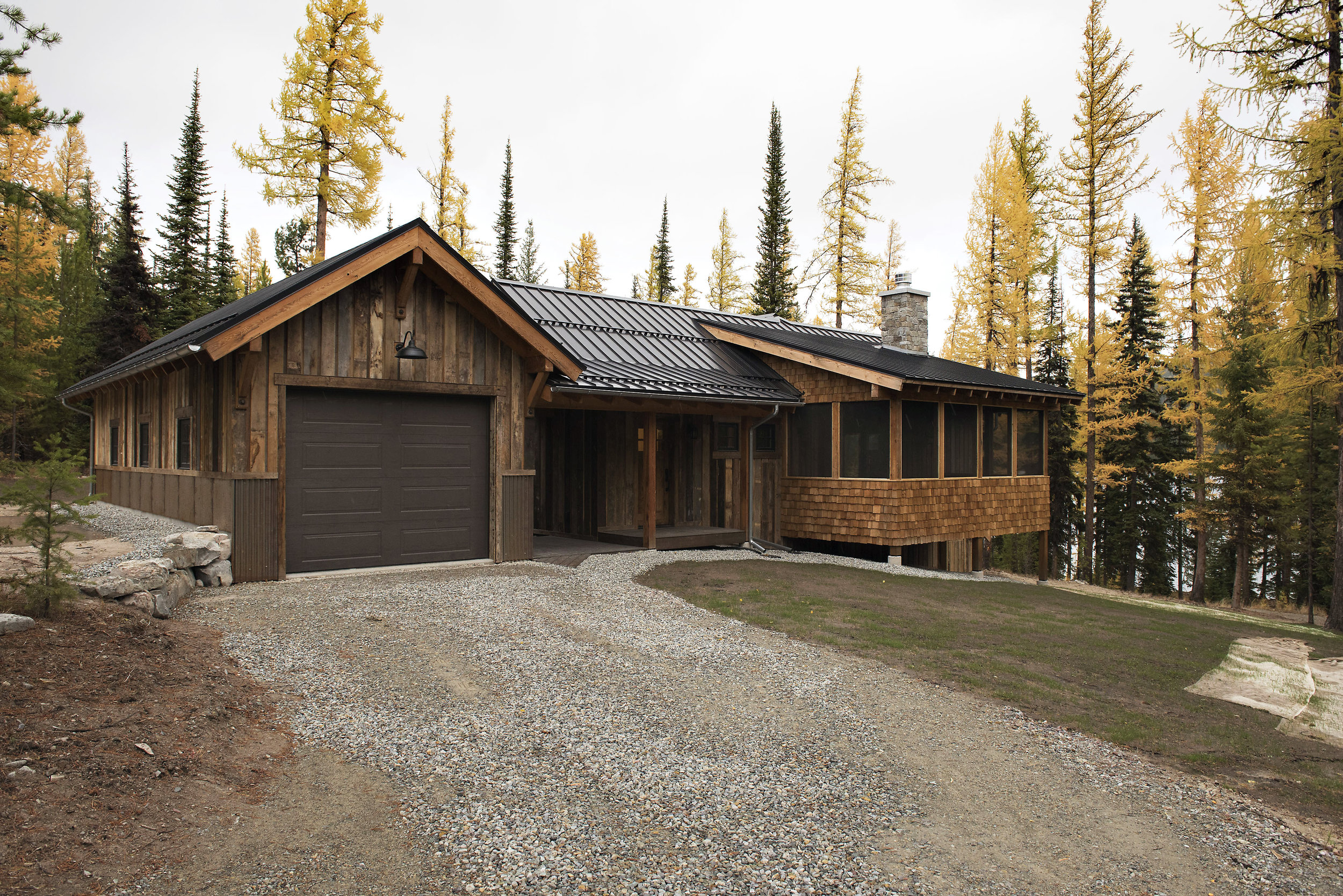 Reverse board & batten reclaimed siding gives the exterior of the cabin a warm & rustic feel - perfect for it's lakeside location amongst the beautiful tamaracks of Northwestern Montana!