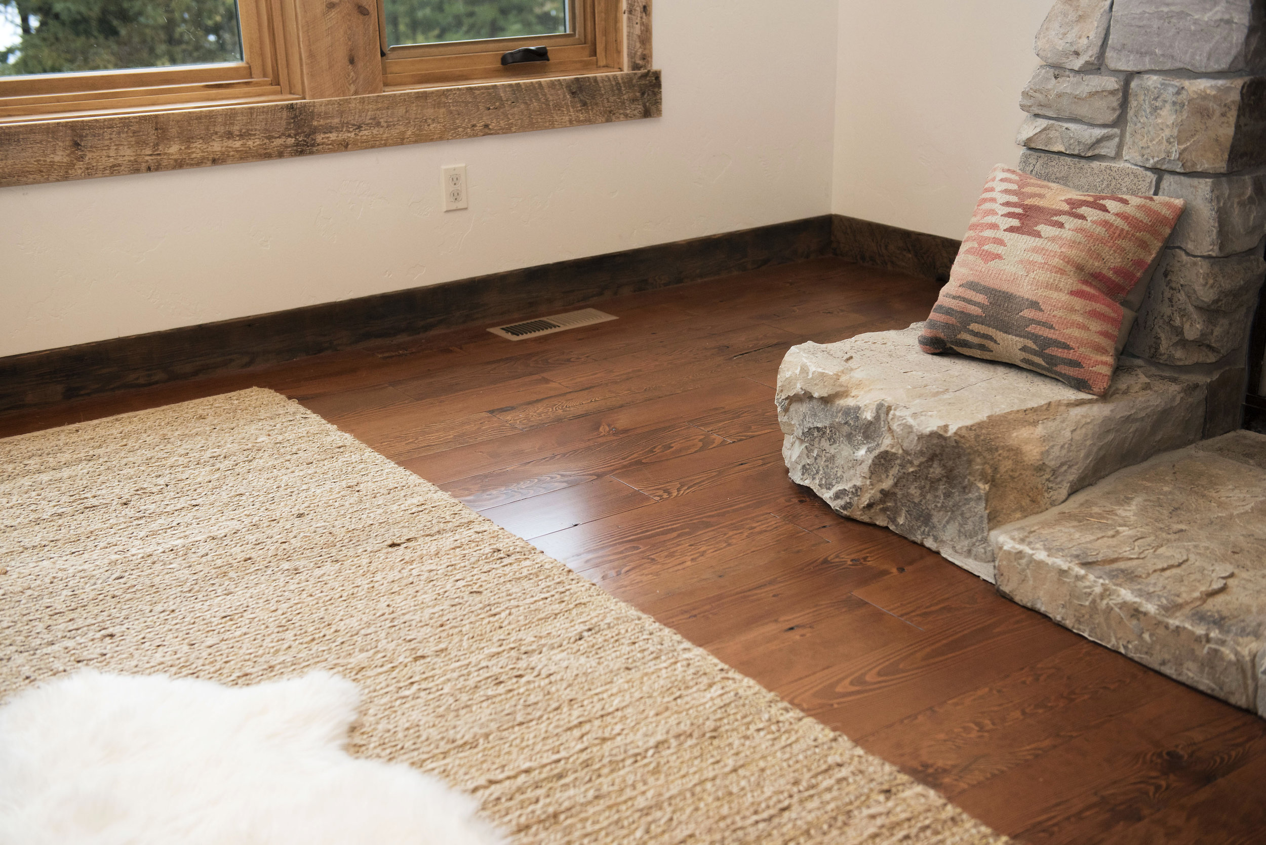 A detail of the reclaimed flooring which we sold unfinished. The homebuilder stained & sealed the material on site.