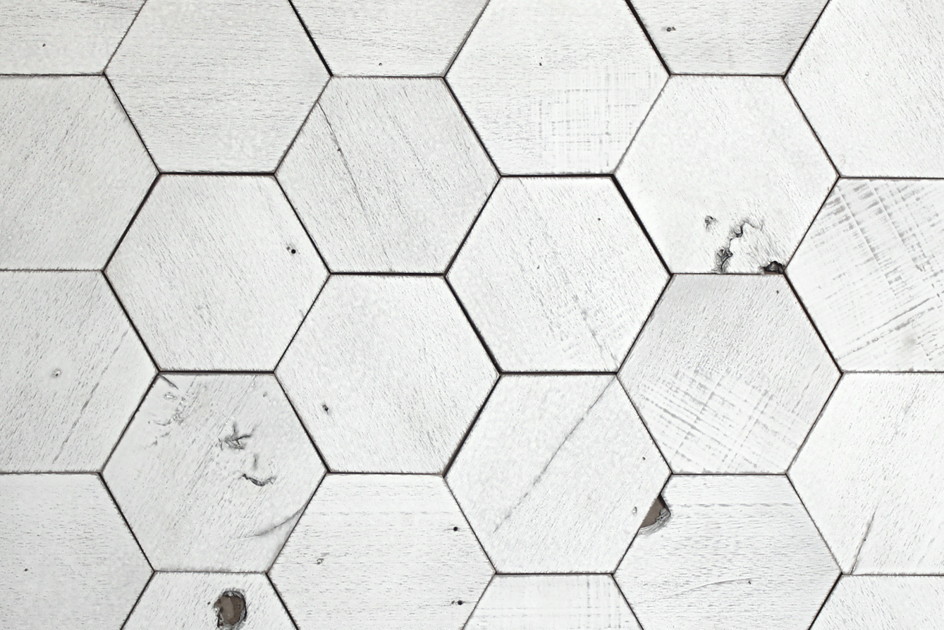 "Our hexagon wood tiles measure 6"" wide and are available in any of our paneling finishes."