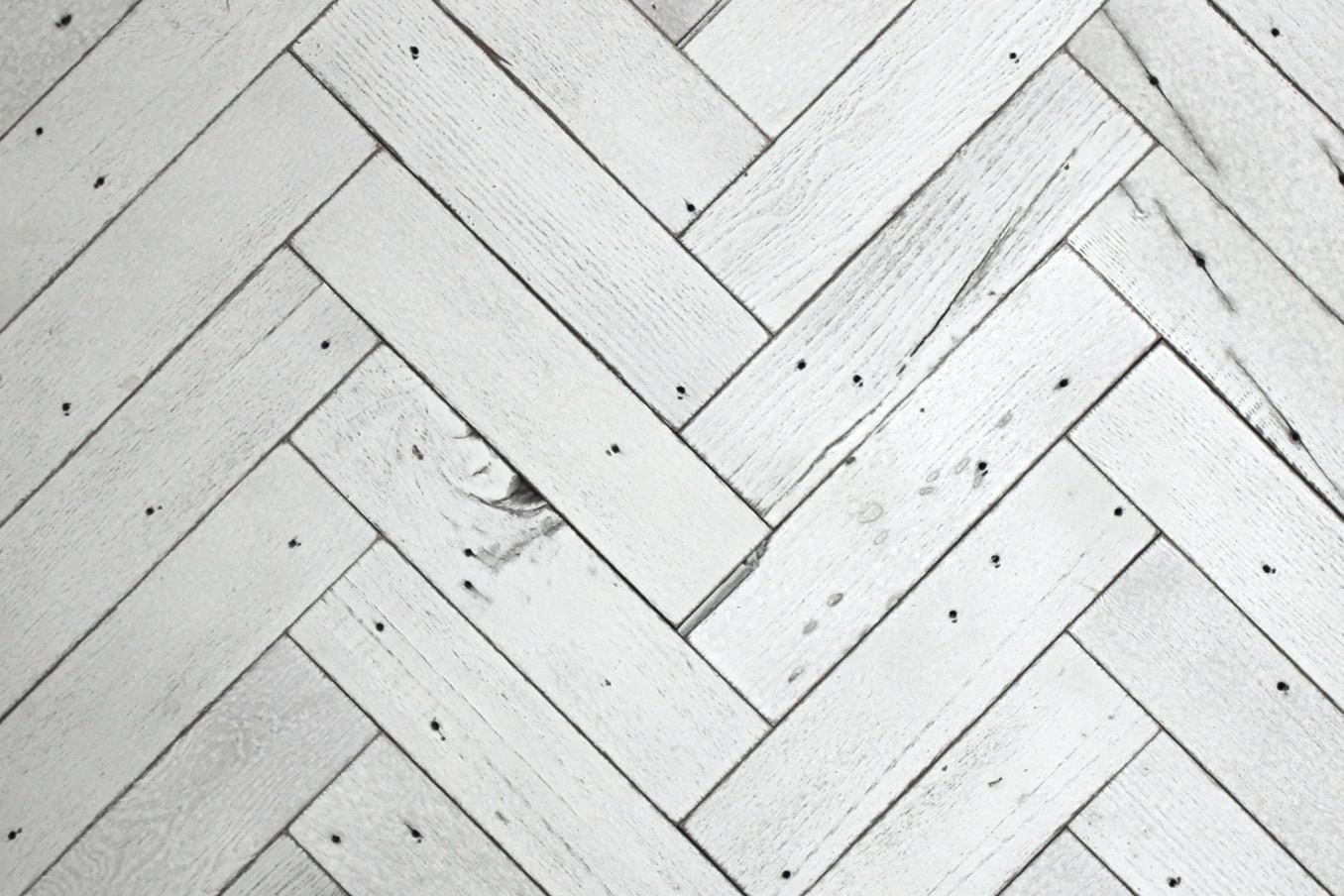 Herringbone style reclaimed wood tiles are available in any of our paneling finishes.