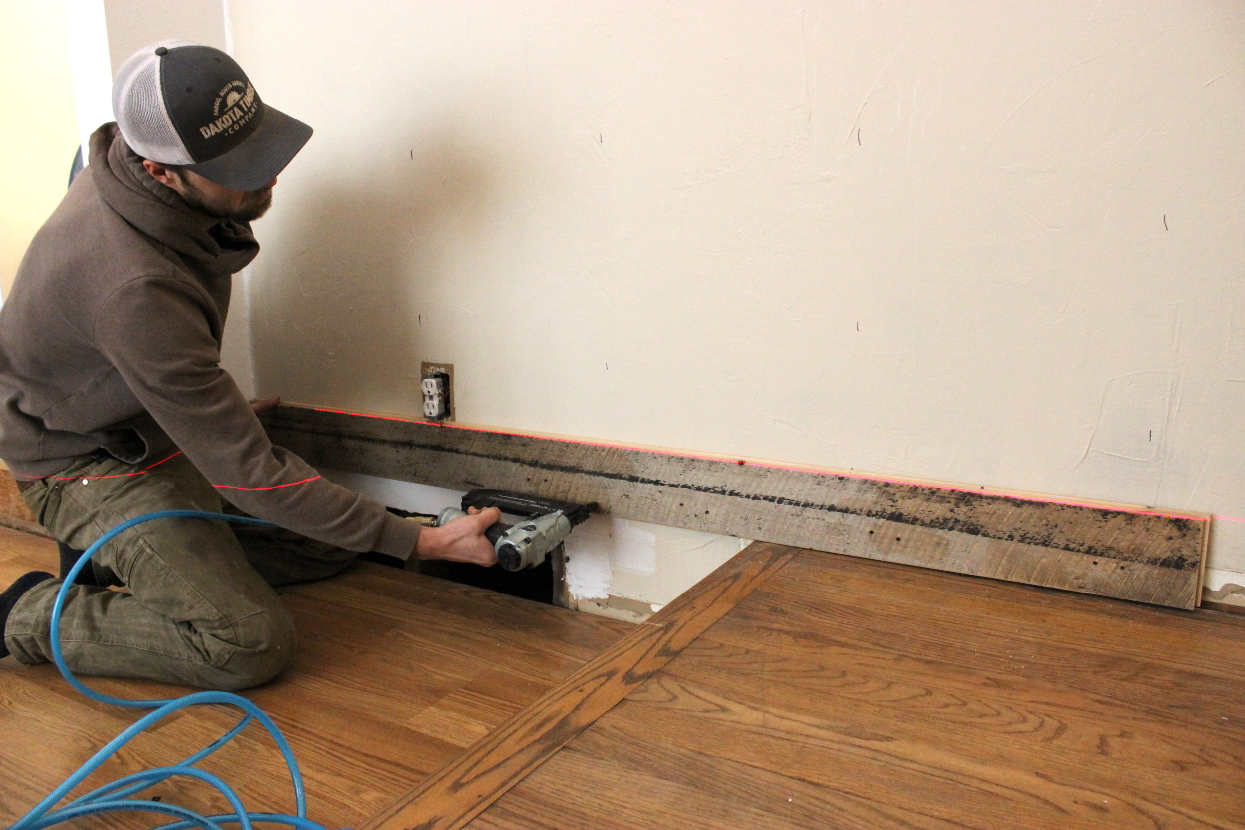 3 How to Install Reclaimed Wood Wall Level first board .JPG