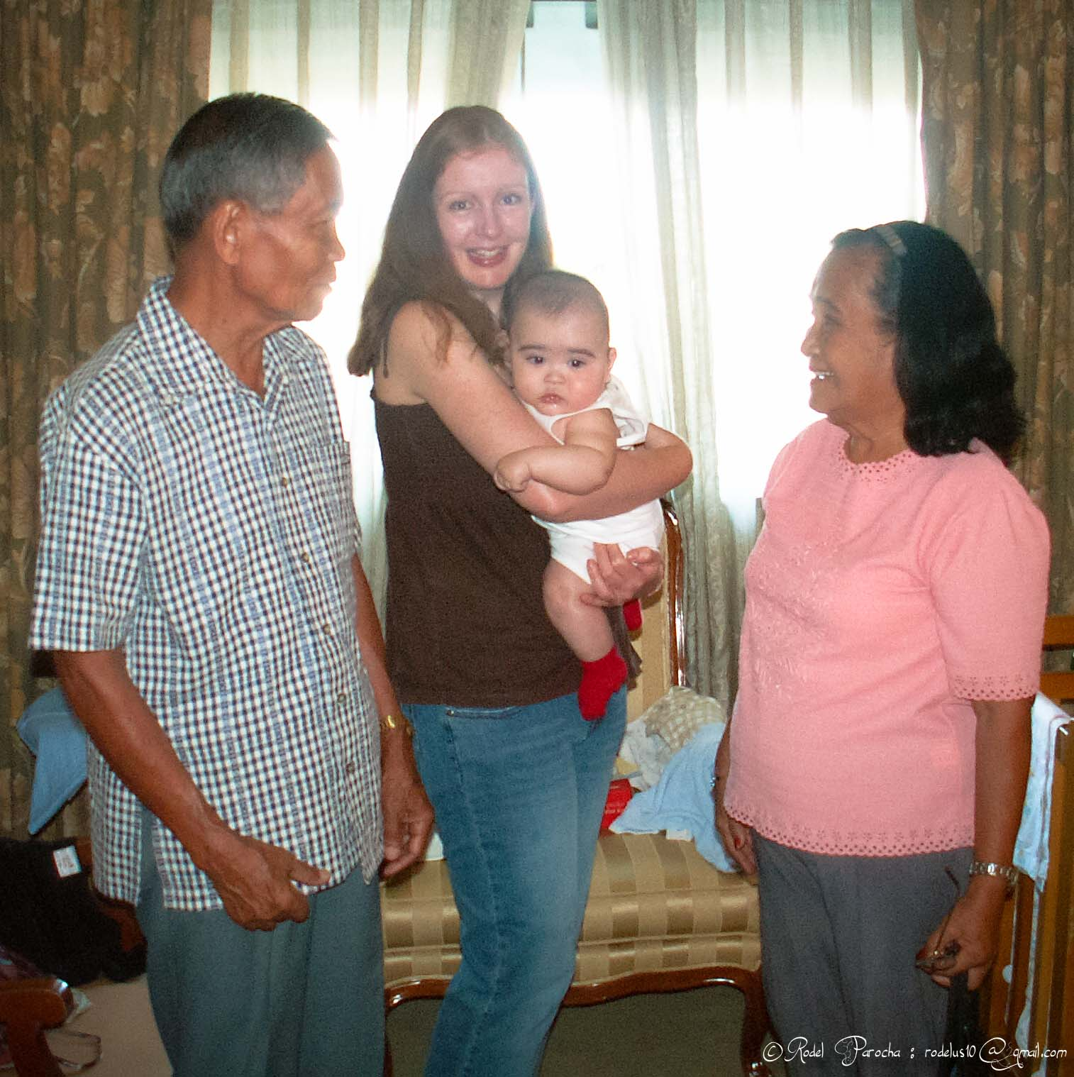Patrick's first meeting with his Lolo (Grandpa) and his Lola (Grandma)... He was a gigantic 5month old baby. In this photo, Mum and Dad were deciding who should take Patrick from his Mum's arms first - of course it was Lola.Photo was taken in the summer of April 2006 at Intercontinental Hotel Makati City, Philippines.