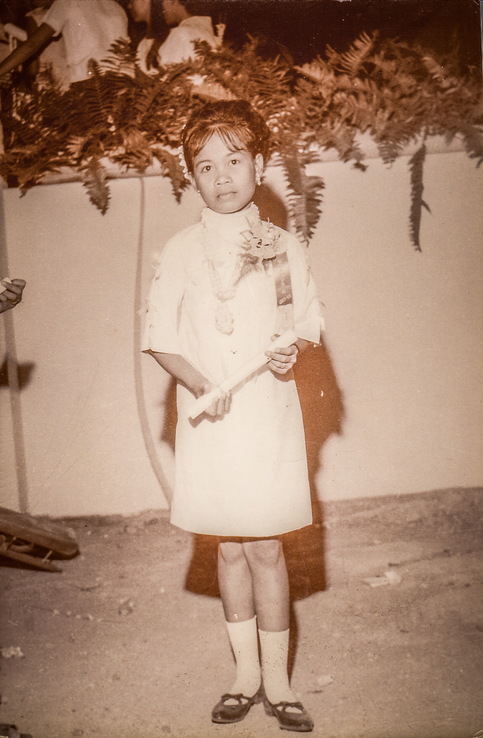 My sister Ate May when she graduated from high school. She was so tiny.