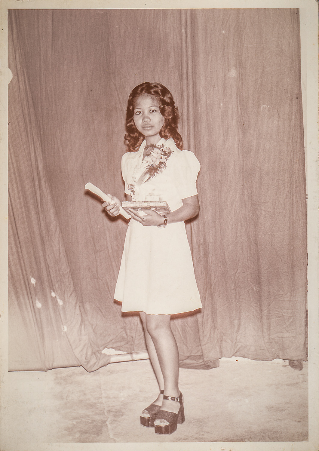Ate Del graduating from high school. She was probably 16 or 17 yrs old. Those shoes, those killer shoes.