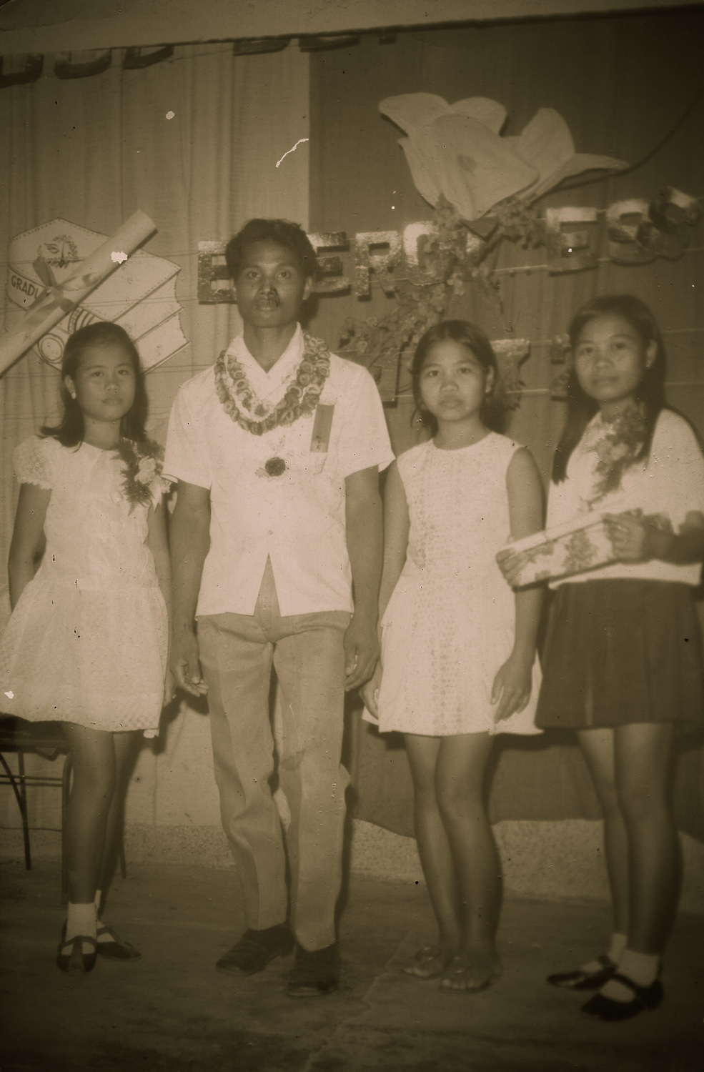 My three sisters Ate Grace (Left), Ate Del (Centre) and Ate May (Right). There were in their early teens. I don't know who the dude was though, I don't care about him.