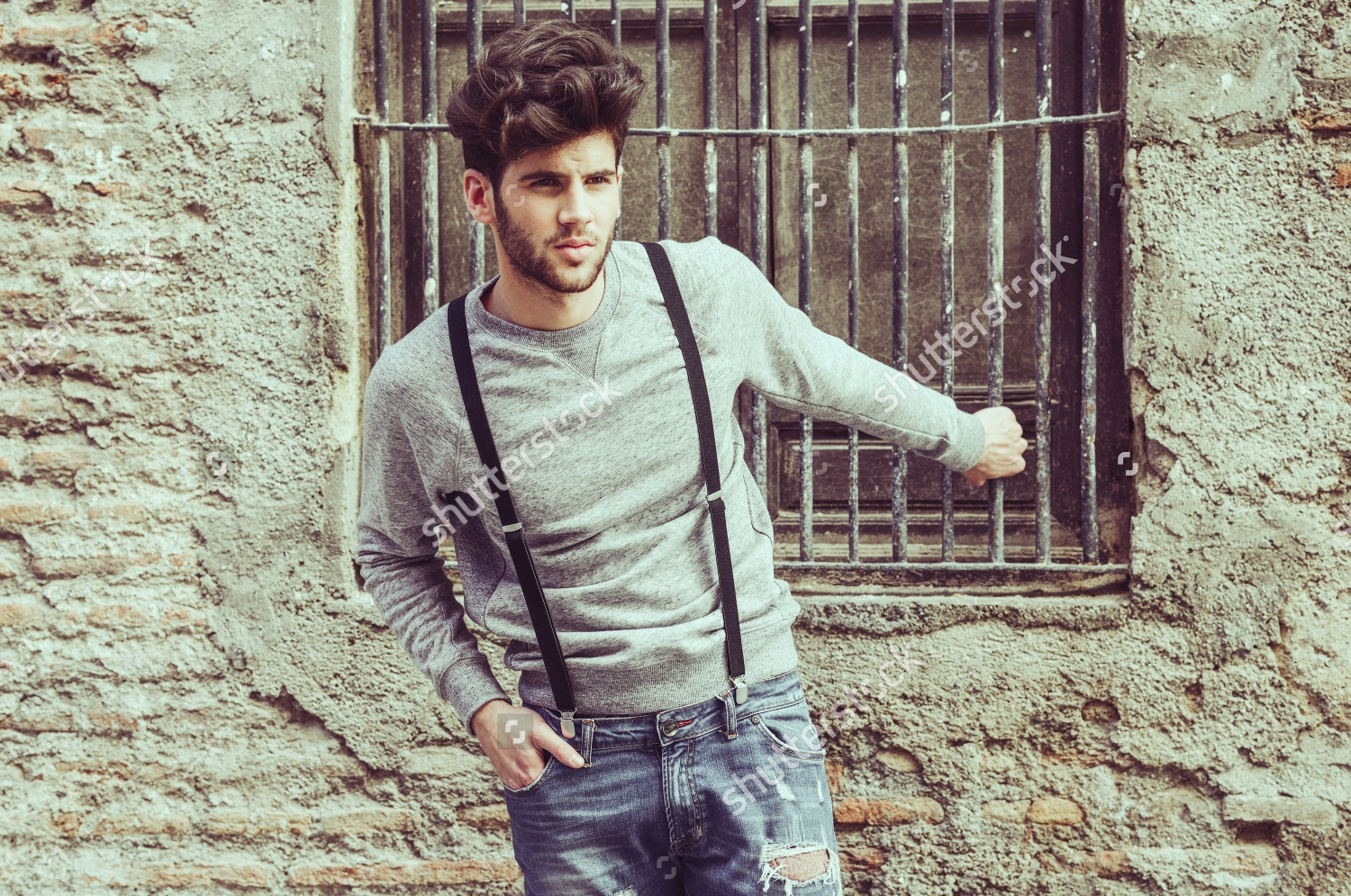 stock-photo-portrait-of-young-man-wearing-suspenders-in-urban-background-201562778.jpg