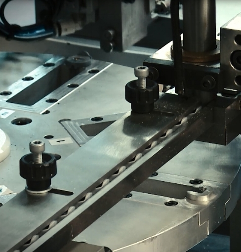 Assembly - Here two rotary tables feed each other. With four bowl feeders, 12 stations and 4 quality checks - both vision and mechanical, this machine assembles, taps and quality checks at a rate of 25 parts per minute. It runs at 92% OEE with