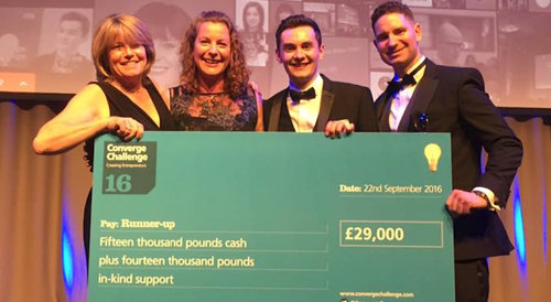 Image: Chris and members of the Estendio board collecting a cheque of £29,000 at Converge Challenge 2016.