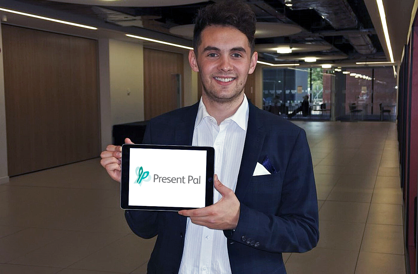 IMAGE: CEO Chris holding tablet with Present Pal