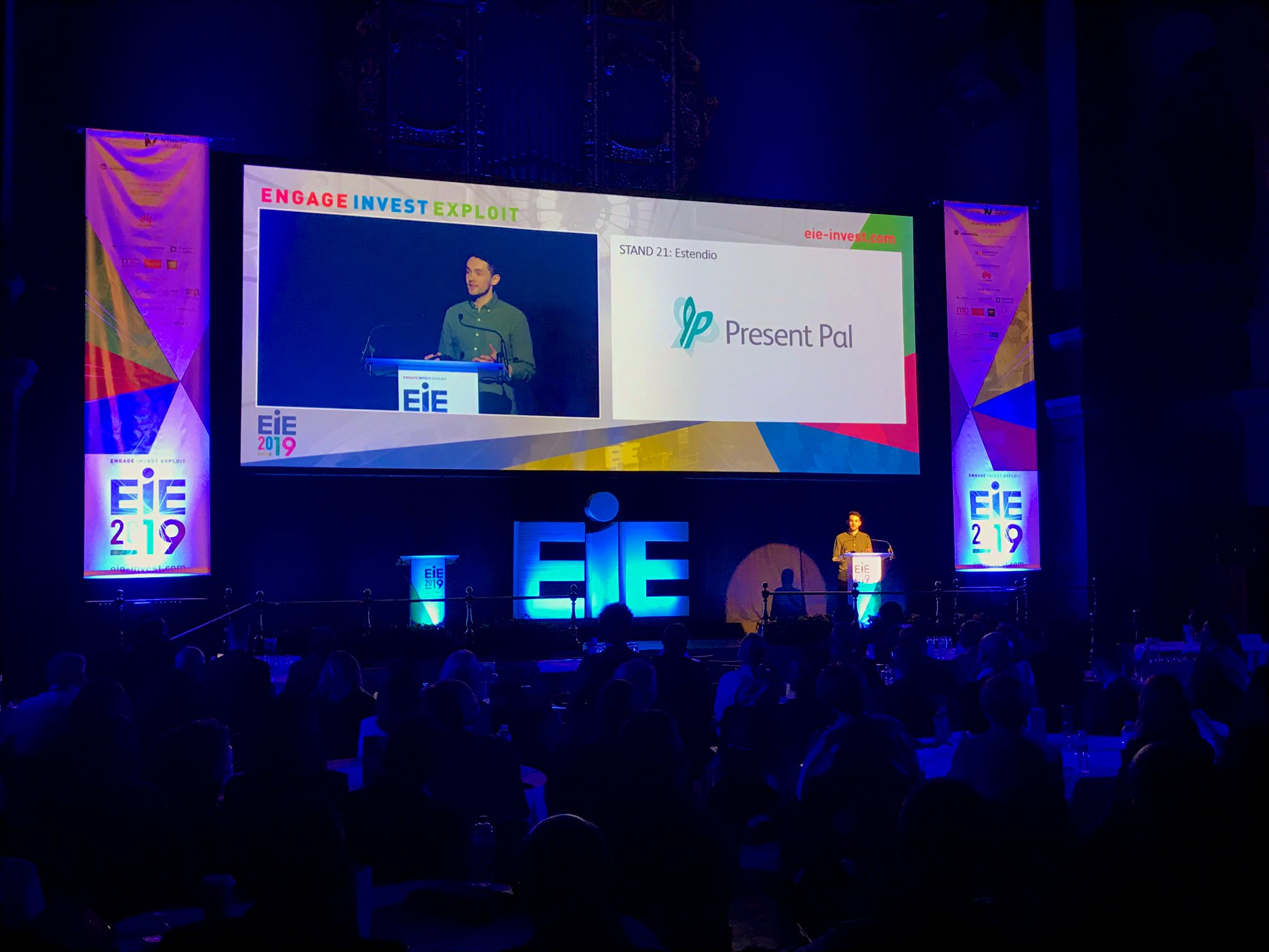 IMAGE: Chris Hughes pitching on stage at McEwan Hall for EIE 2019.