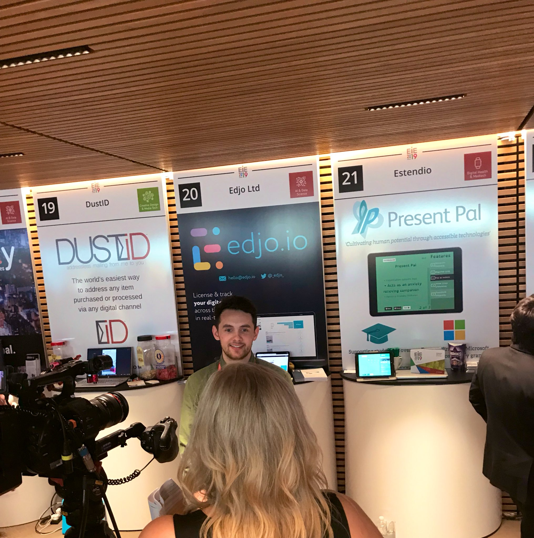 IMAGE: Chris Hughes being interviewed at EIE 2019 in front of our Present Pal stall.