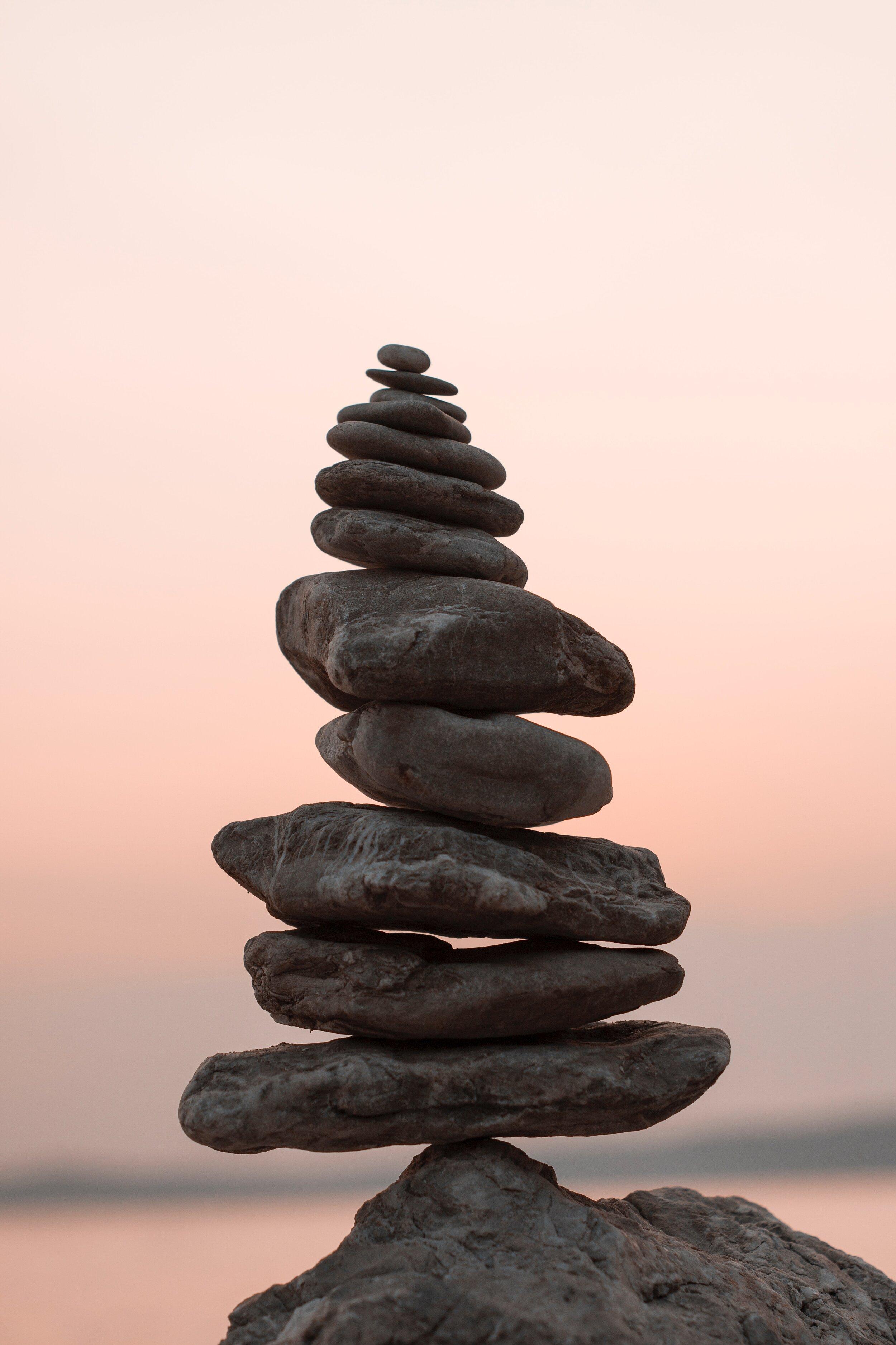 Image Description: A tower of stones balancing