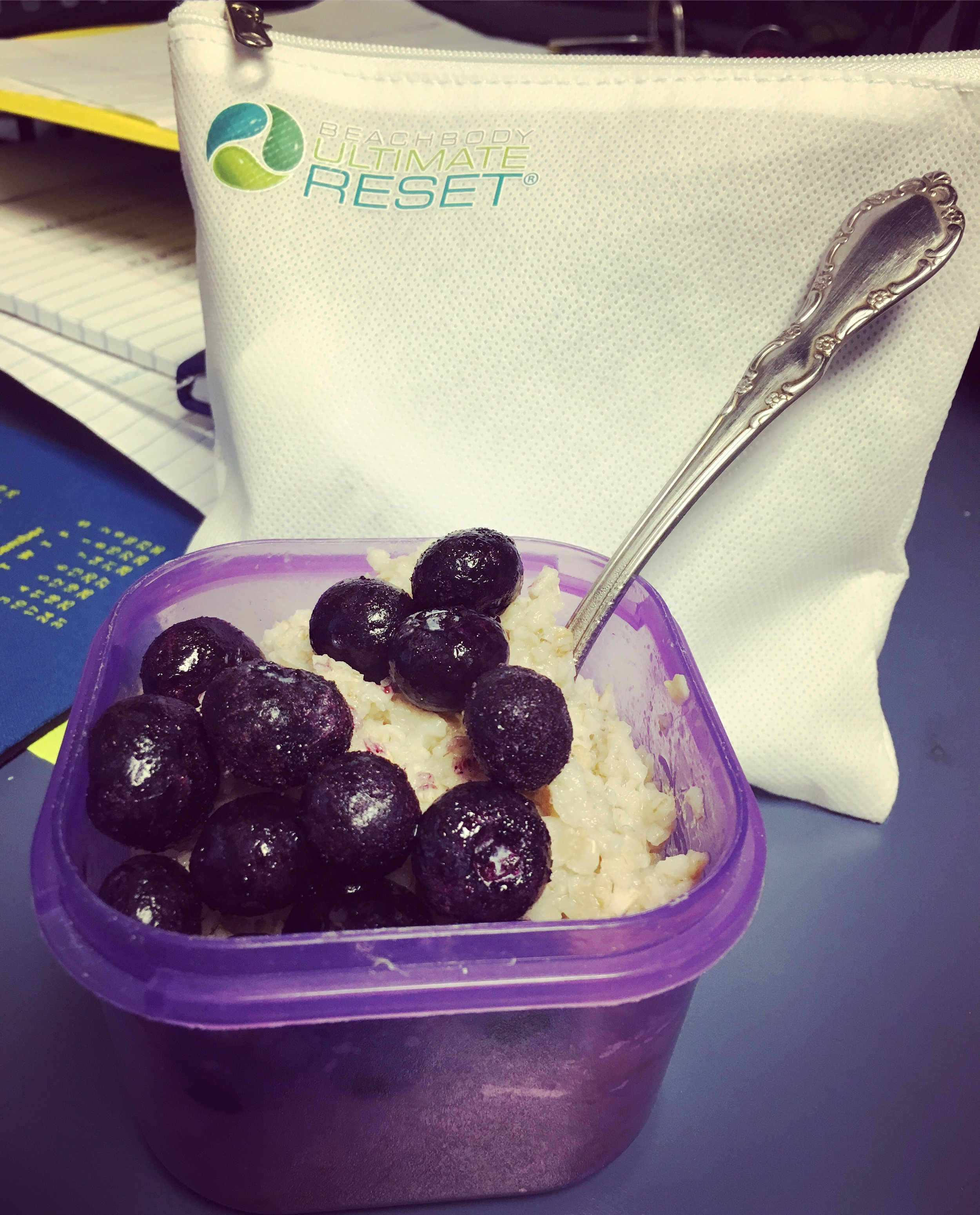 My kind of breakfast - blueberry oatmeal and my little Reset goody bag!