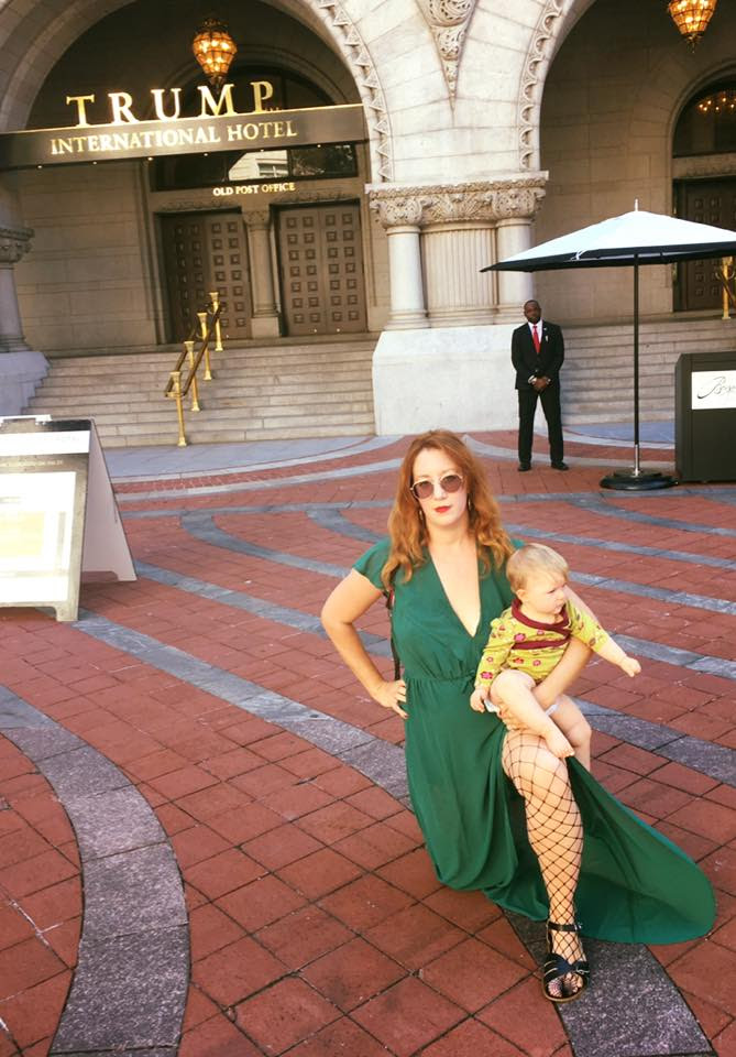 Bob Bland, Co-Chair of The Women's March, with her baby Chloe, as they #TakeAKnee in front of The Trump International Hotel in Washington DC.
